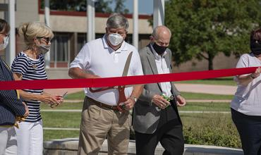 Board Chair Jim Kitch is joined by Dr. Juanita Krittenbrink and Dr. Kent Carder to cut the ribbon on the remodeling project.