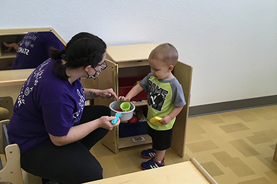 A Redlands student enjoys working with children at a child development center.