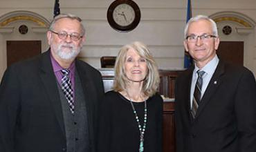 Redlands Community College President Jack Bryant (left) and Sen. Darcy Jech (right) congratulate Dr. Juanita Krittenbrink on her reappointment to the college's Board of Regents.