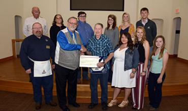 Masonic Lodge officers present check to Aggie Club.