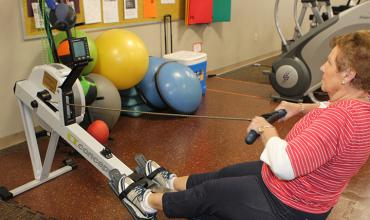 Fitness member uses the rowing machine.