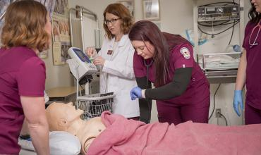 Students learn in the nursing lab