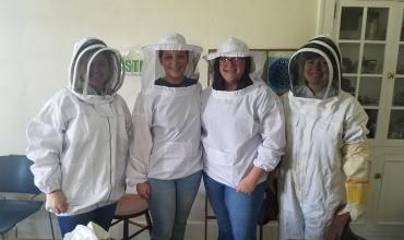 Students Chloe Miller, Ella McReynolds, Naomi Miller and Tricia Virtue suit up for working with the BlueSTEM beekeeping project.