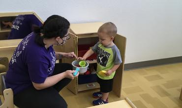 Redlands student works with a child at the Canadian Valley Child Development Center